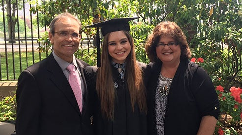 Alexandria Campbell Kalina AB '82 with her daughter, Maria AB '16, and husband, Paul, on Commencement Day at Harvard.
