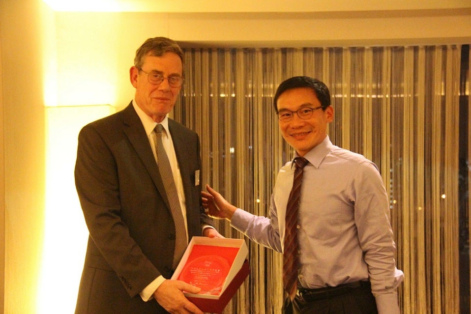 Dr. Peter K. Bol, Vice Provost for Advances in Learning, with Henry Ho AB '95, Vice President of the Harvard Club of Taiwan