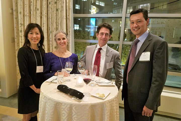 Four Associates donors at the reception in Boston