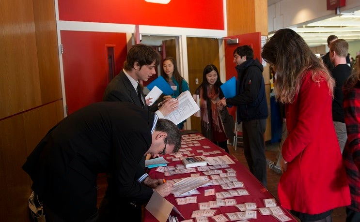 Students sign in at the Public Interested Conference