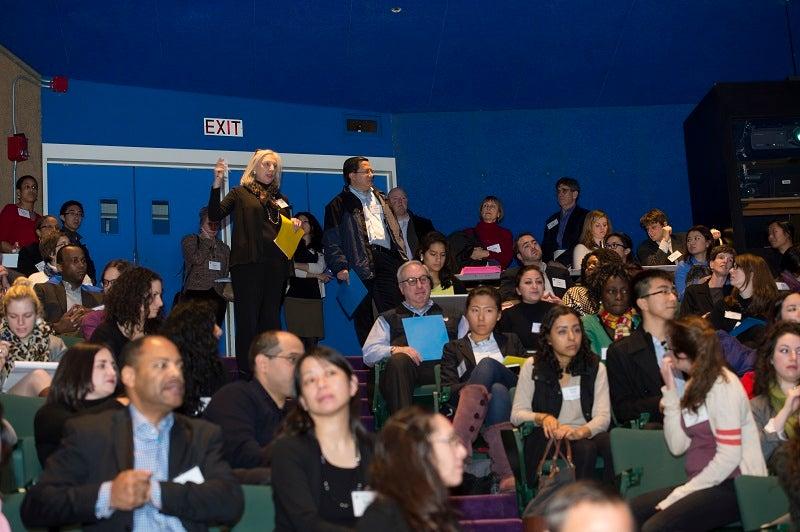 Attendees await a presentation