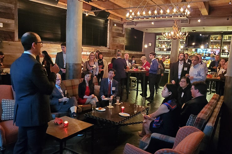 Associates donors listen to a speaker in Boston