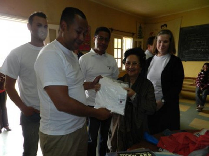 FAZAKO administrator receives an HAA Madagascar shirt.