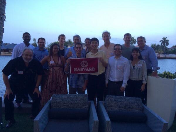 Alumni hold a Harvard banner at the GNN event in Ft. Lauderdale, FL.