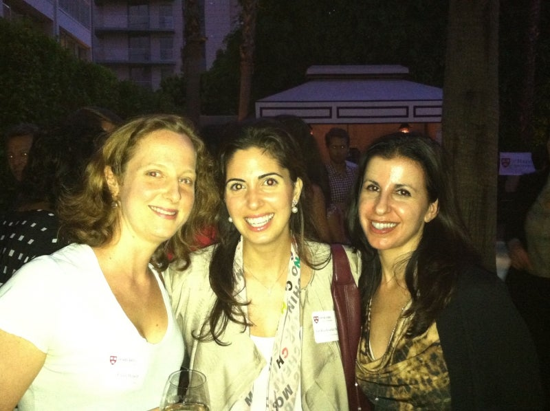 Three alumnae pose for a photo at Global Networking Night in Los Angeles, CA.