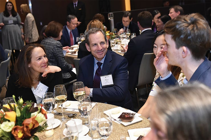 Guests chat at the President's Associates Dinner in 2019