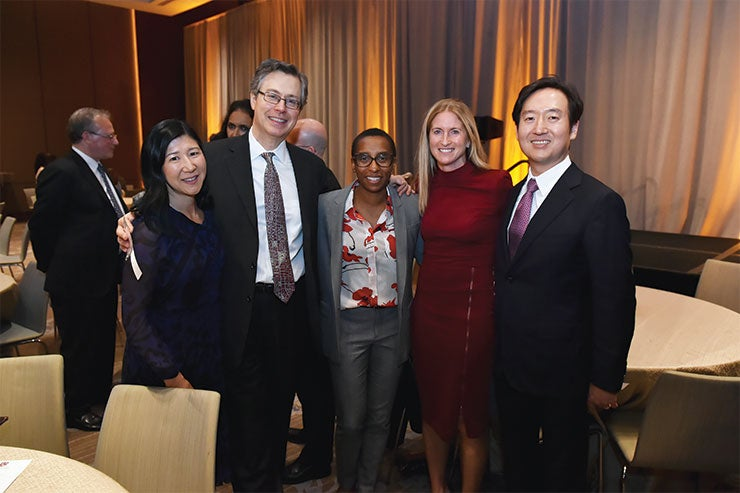 Hosts and speakers pose for a picture at the President's Associates Dinner in 2019