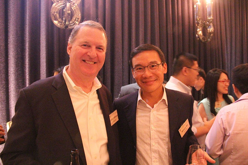 Alumni Jeffrey Williams AB '78, MBA '82 and Henry Ho AB '95 at GNN in Taipei, Taiwan.