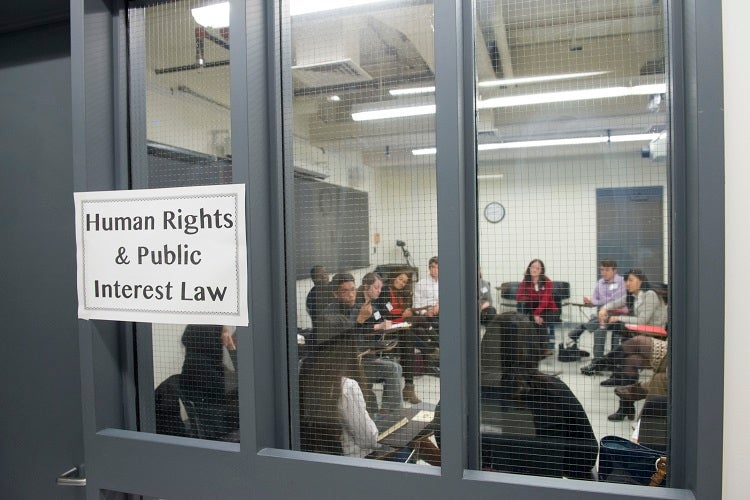 Students and alumni attend a breakout session on human rights and public interest law.