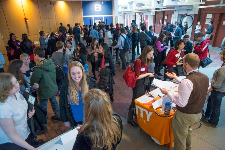 Students and alumni fill the Science Center for a networking reception.