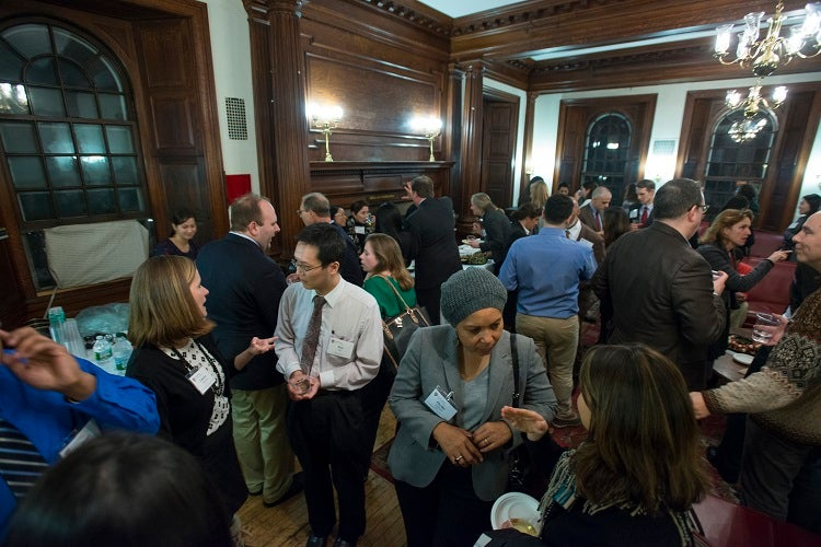 Alumni fill the reception room after a day of presentations, networking, and breakouts.