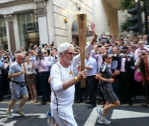 Don Guiney '78 carried the Olympic torch through the streets of London.