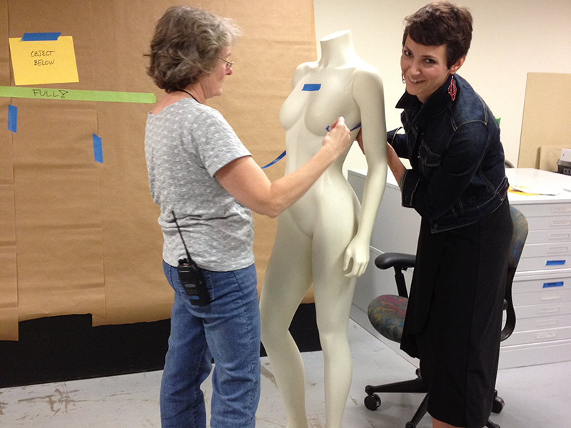 Preparing a mannequin for a Maria Pinto exhibition