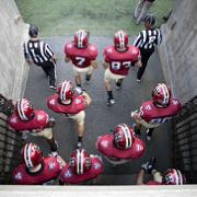 The Harvard Crimson take the field.