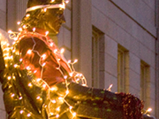 John Harvard statue in lights