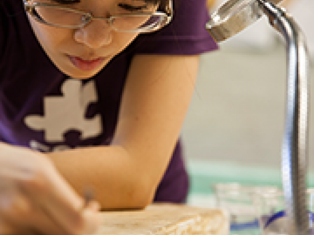 Rebecca Chen '16 works on a resin cast of an Assyrian relief.