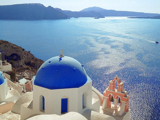 blue roofed building in Santorini