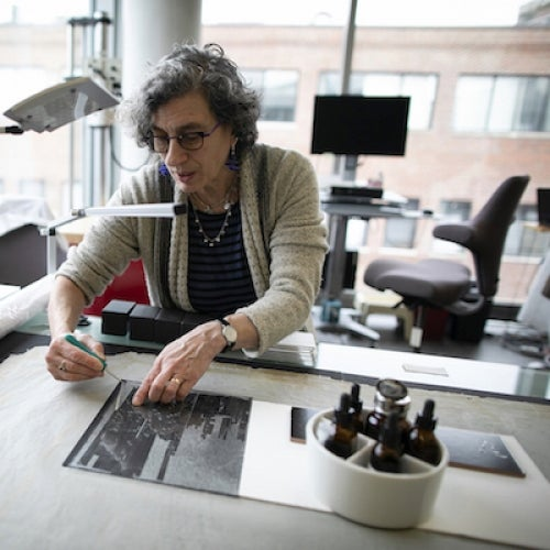 Helen H. Glaser Conservator Debora Mayer prepares collections for treatment using high-resolution, digitally scanned images