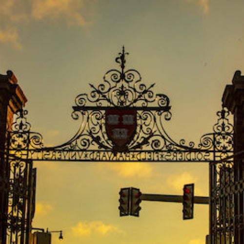 A gate at Harvard University on Soldiers Field Road, which runs beside the athletic complex