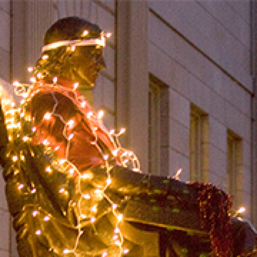John Harvard statue in lights