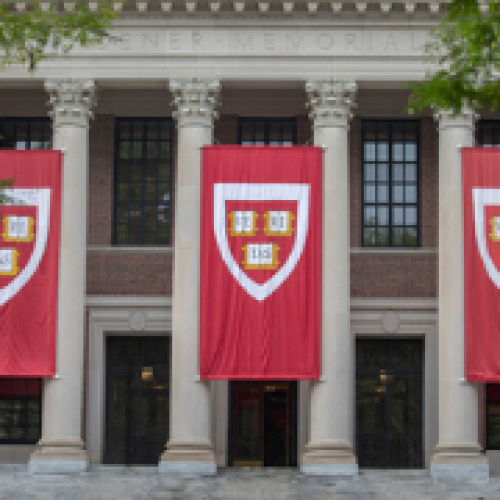 Veritas banners in front of Widener Library