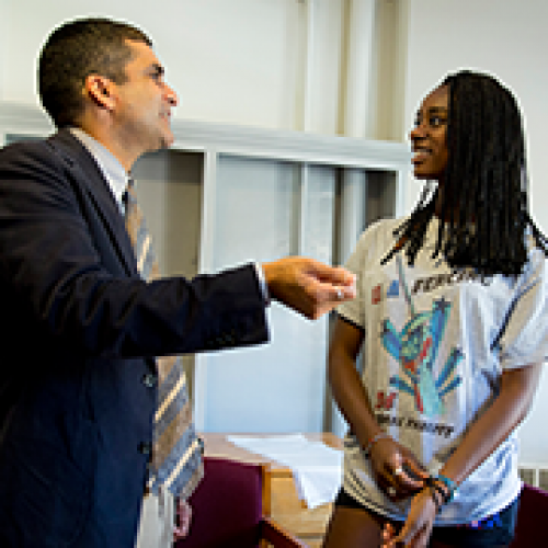 Harvard College Dean Rakesh Khurana greets MacKenzie Lawrence '18